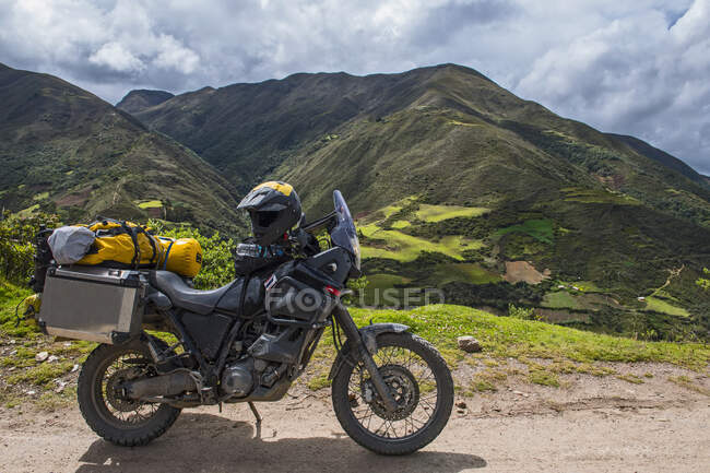 Off road motorbike with luggage  standing on the road.  Peru — Stock Photo