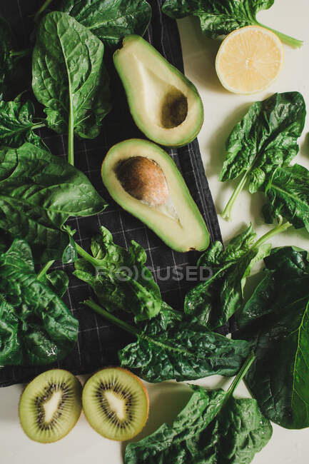 Fresh green vegetables and fruits on  background. healthy eating. — Stock Photo