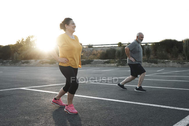 A middle-aged couple are doing exercises with social distance — Stock Photo