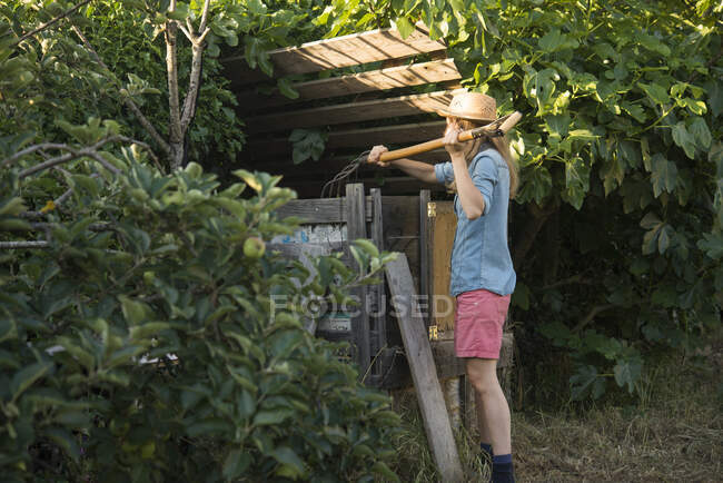 Woman putting food scraps into compost — Stock Photo