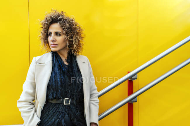 Portrait of woman on yellow background — Stock Photo