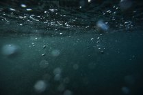 Air bubbles under sea water — Stock Photo