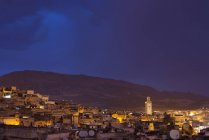 Scenic view of old town buildings with night sky, Morocco — Stock Photo
