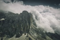 Rocky mountain peaks surrounded by clouds — Stock Photo