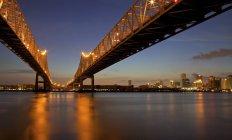 Crescent City Connection twin bridges illuminated at night — Stock Photo