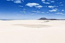 Desert landscape with vivid blue cloudy sky, Canary Islands, Spain — Stock Photo