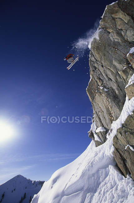 Chris Davenport jumping from cliff at Alta, Utah. — Stock Photo