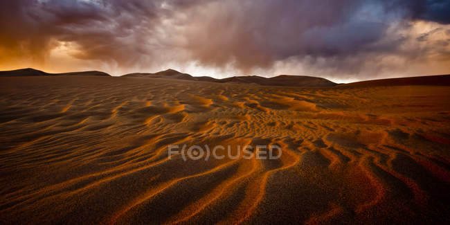 Sand dunes under stormy sky — Stock Photo