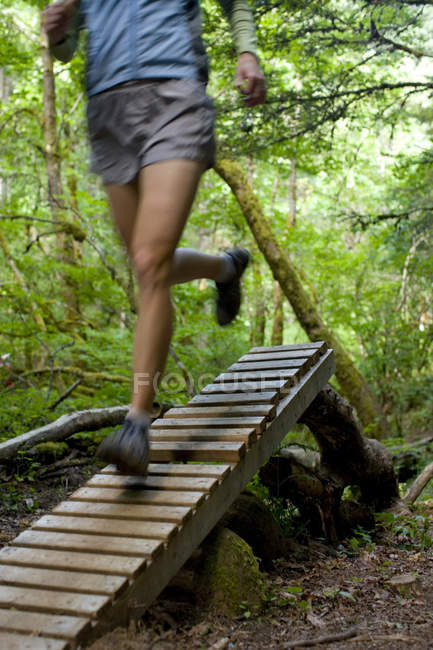 Cropped view of woman trail running near Hood River, Oregon — Stock Photo