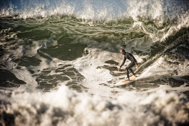 Man in wetsuit surfing, selective focus — Stock Photo
