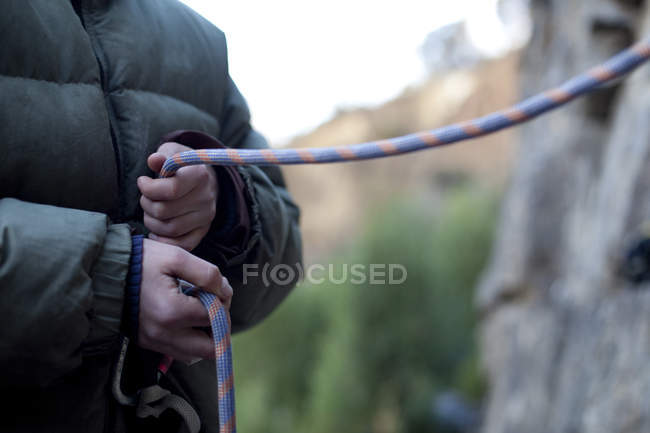Female hands holding belay device, selective focus — Stock Photo