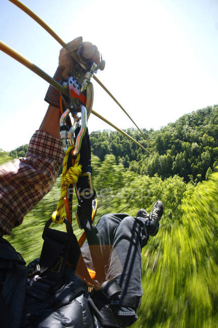 Cropped view of man crossing zipline at Navitat Canopy tour near Asheville, North Carolina — Stock Photo