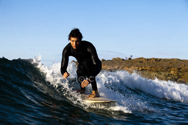 Male surfer riding longboard while surfing in Northern Baja, Mexico — Stock Photo