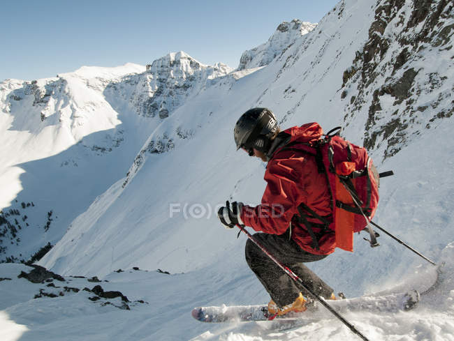 Man backcountry skiing on melting snow, San Juan National Forest, Silverton, Colorado — Stock Photo