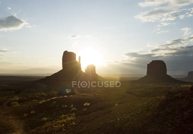 Monument valley rock formations with sunset backlit — Stock Photo