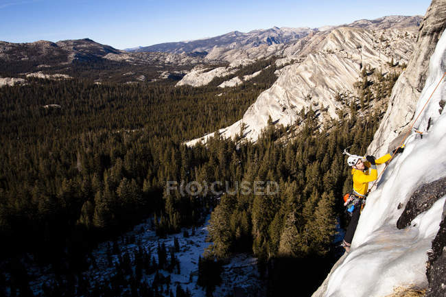 Man climbing Yellow Brick Road on Drug Dome in Tuolumne Meadows located inside Yosemite National Park, California — Stock Photo