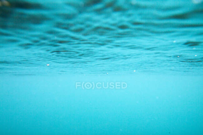 Azure wavy water surface shot — Stock Photo