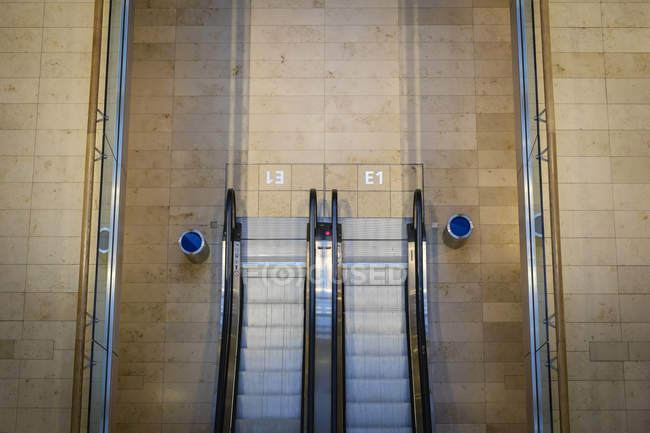 Elevated view of moving escalator at subway station — Stock Photo