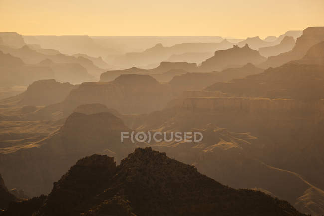 Grand Canyon rock formations in sunset light — Stock Photo