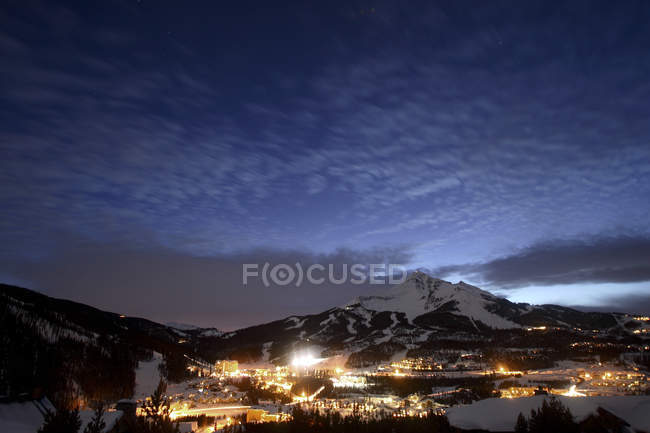Big Sky Resort village buildings glowing at dusk, Montana — Stock Photo