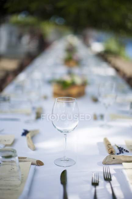Empty glass on served dining table — Stock Photo