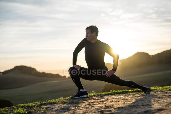 Man exercising outdoors, focus on foreground — Stock Photo