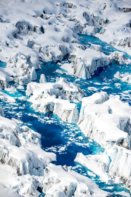 Aerial view of melting glacier and deep blue water — Stock Photo