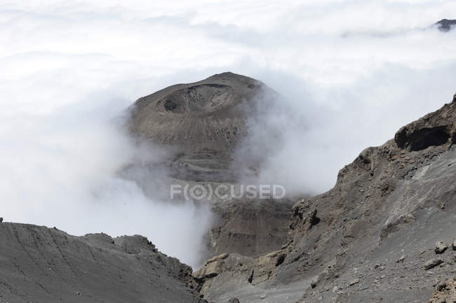 Look down in crater of Mount Meru volcano in smoke, Africa — Stock Photo