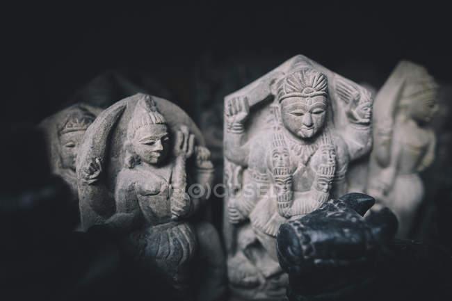 Hindu statues sit in natural light on shelf, Nepal — Stock Photo