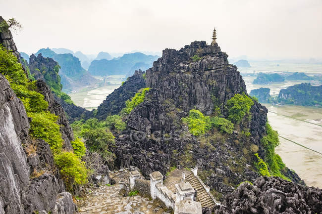 Karst mountain landscape with ancient buildings — Stock Photo