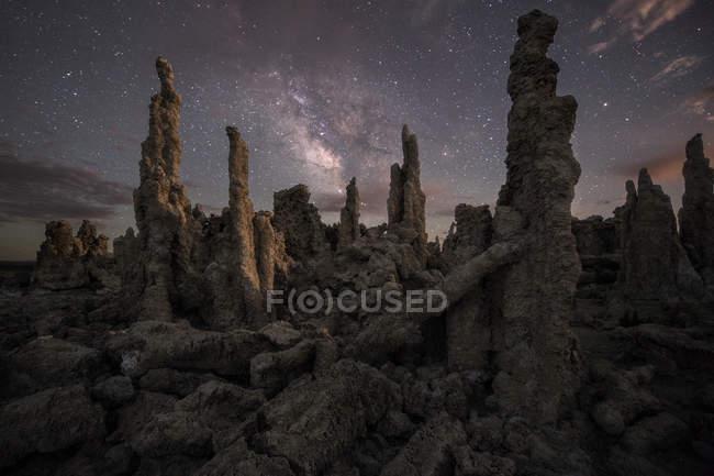 Milky way stars shining above rock formations — Stock Photo