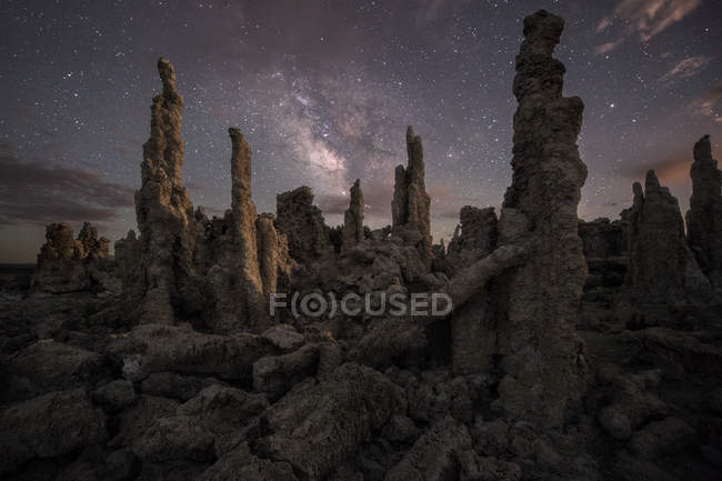 Milky way stars shining above rock formations — Stock Photo