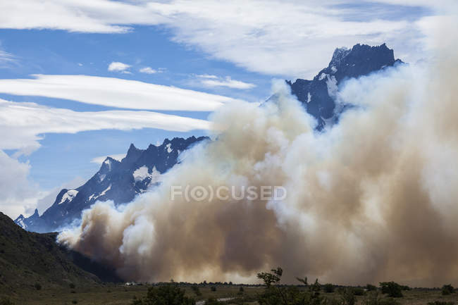 Smoke from human caused fire in mountain woods, Torres del Paine in Chilean Patagonia — Stock Photo