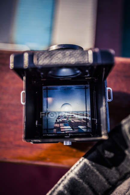 Container ship on water through vintage camera viewfinder — Stock Photo