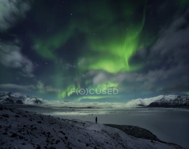 Silhouette of person watching Northern Lights — Stock Photo