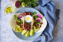 Top view plate of veggie tacos with sauce on marble table — Stock Photo