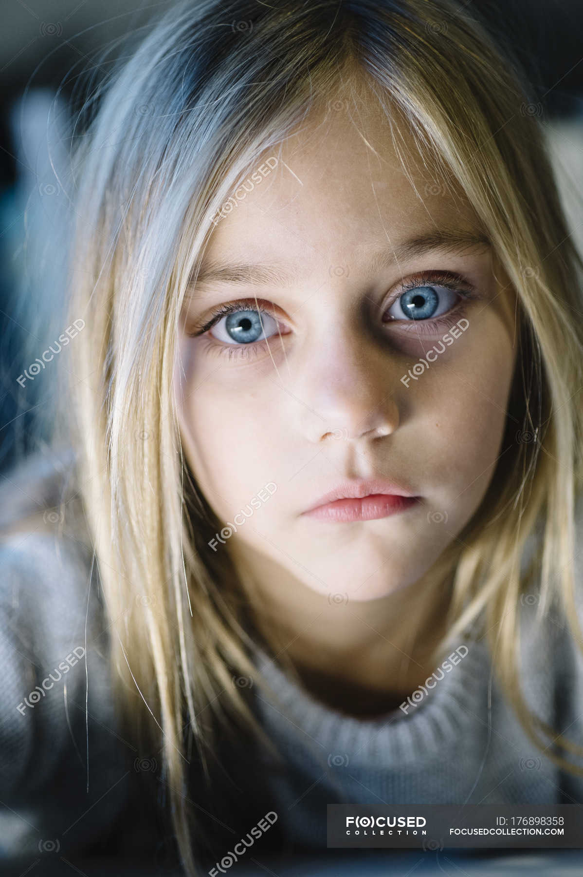 Beautiful Blonde Preteen Girl With Big Blue Eyes Looking