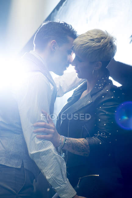 Man in classic wear and tattoed woman standing close to each other — Stock Photo