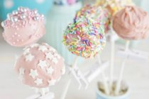 Closeup view of cake pops cookies with icing on sticks — Stock Photo