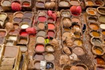 Traditional leather tannery stone bowls in medina quarter of Fez, Morocco, Africa. — Stock Photo