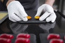 Close-up view of confectioner making chocolate candies — Stock Photo