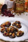 Chocolate candies decorated with nuts and dried fruits — Stock Photo