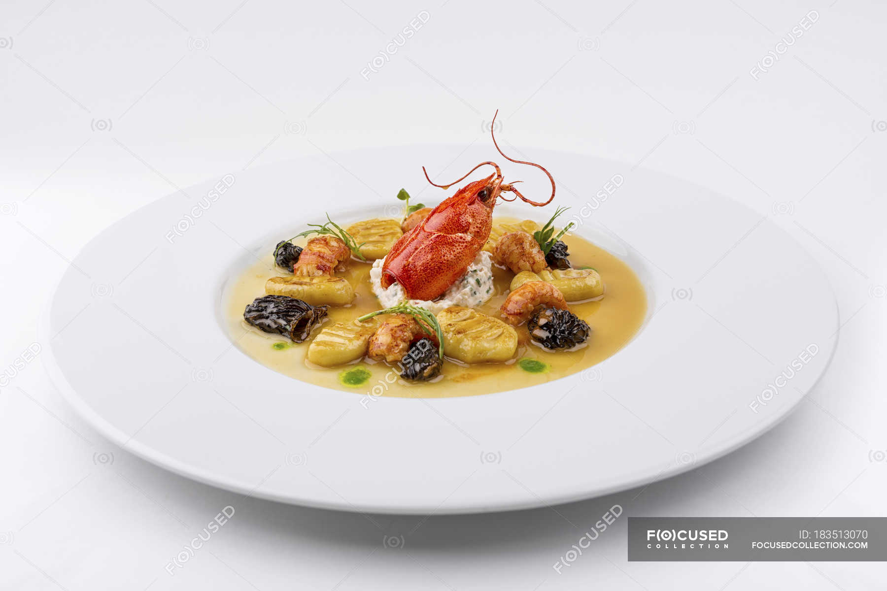Lobster dish with gnocchi and morels ...