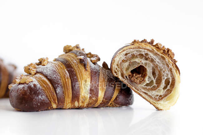 Croissants with striped pattern on white background — Stock Photo