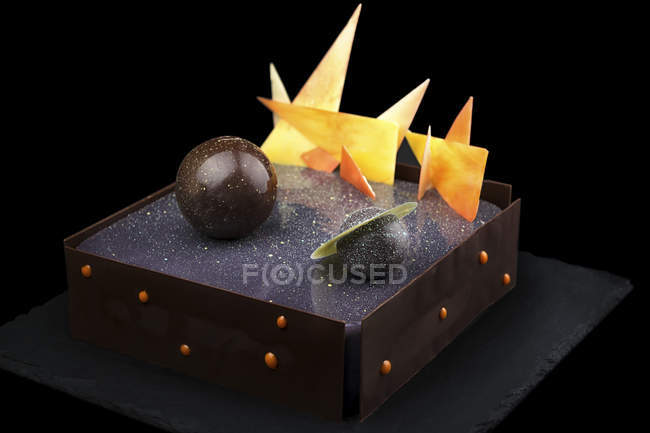 Chocolate cake with galaxy glaze and planets decorations — Stock Photo