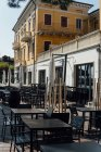 Empty outdoor cafe with black furniture — Stock Photo