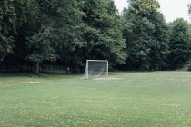 Empty football field at park during summer time — Stock Photo