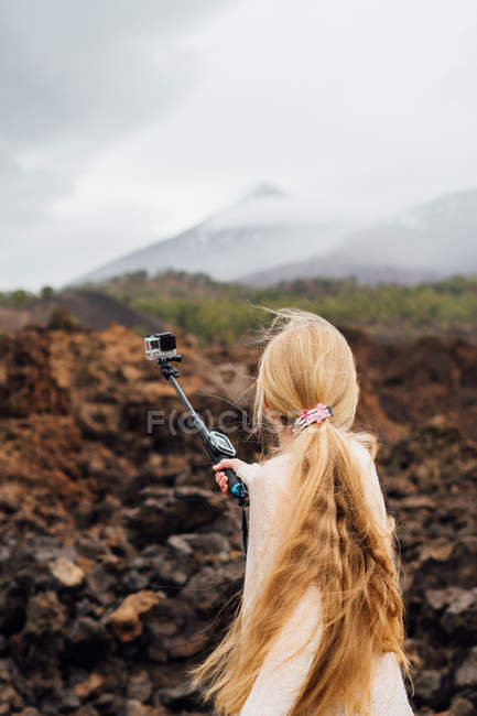 Young woman taking selfie while traveling in mountains — Stock Photo