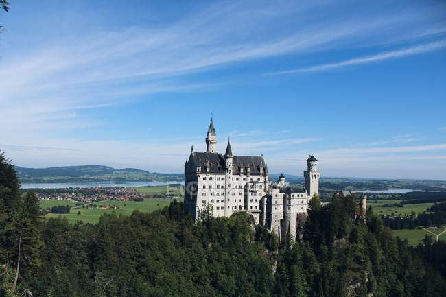 Castle on green hill over bright sky — Stock Photo