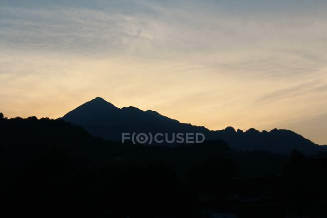 Silhouette of mountain over pastel sky — Stock Photo
